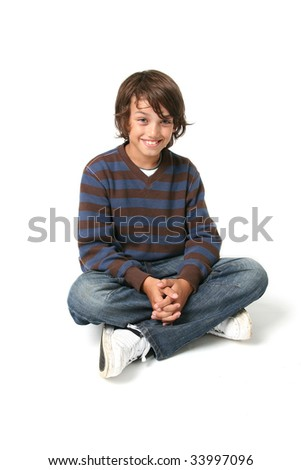 Child boy sitting. happy kid sat isolated on white background with jeans - stock photo