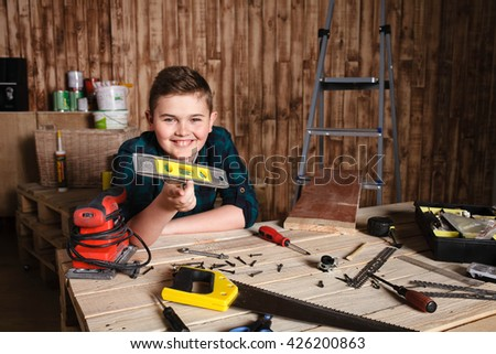 child builder for construction  work concept, funny boy builder shows Tools - stock photo