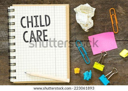 Child care. Child care on notebook crossed paper. Workspace mess: paperclips, stickers, crumpled paper. On wooden table  - stock photo