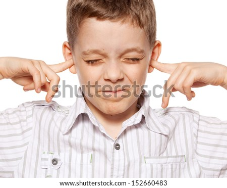 Child closed her ears. Boy ignoring - stock photo