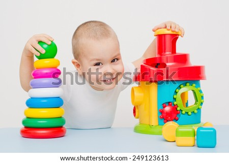 Child collects a pyramid - stock photo