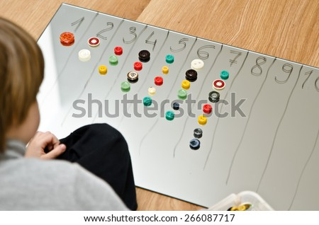 child counts buttons - stock photo