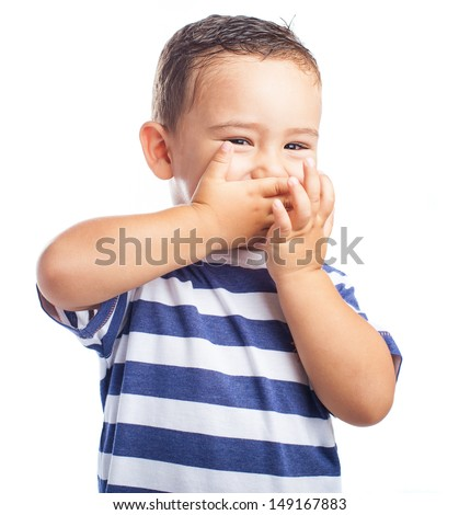 child covering his mouth on a white background - stock photo