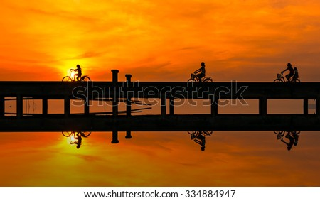 Child cyclists at sunset,Abstract. - stock photo