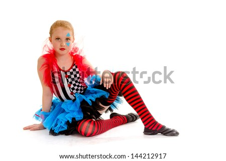 Child Dancer Poses in Costume as a Painted Circus Jester - stock photo