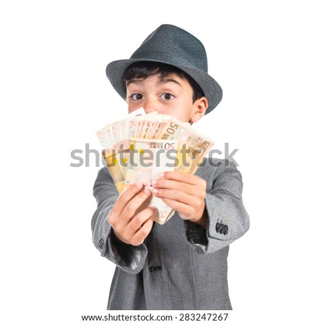 Child doing surprise gesture and holding a lot of money - stock photo