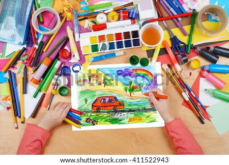 child drawing dog travel in car , top view hands with pencil painting picture on paper, artwork workplace - stock photo