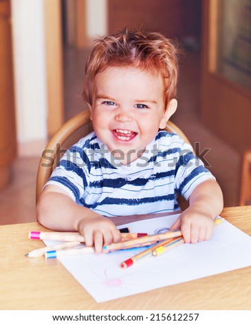 Child drawing indoors - stock photo