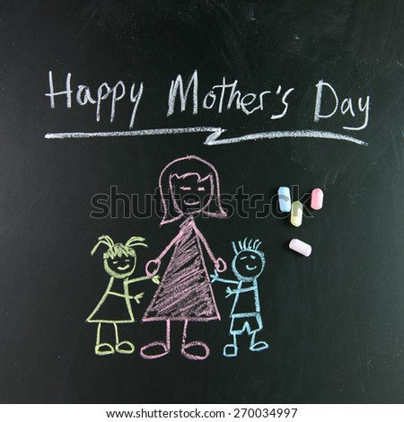 "Child drawing of happy mother""s day picture using chalk on blackboard - stock photo"