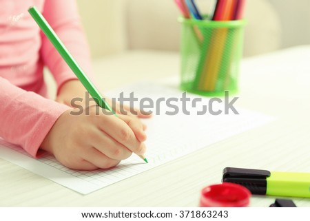 Child drawing with pencils, closeup - stock photo