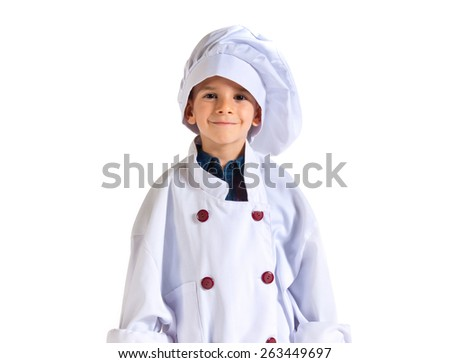 child dressed as a chef - stock photo