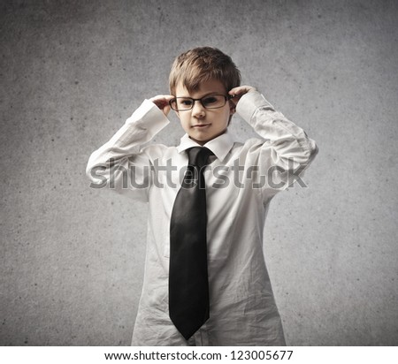 Child dressed as an office worker - stock photo