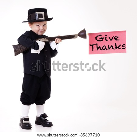 child dressed as Pilgrim and giving thanks - stock photo