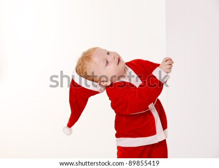 child dressed as Santa Claus on a white background - stock photo