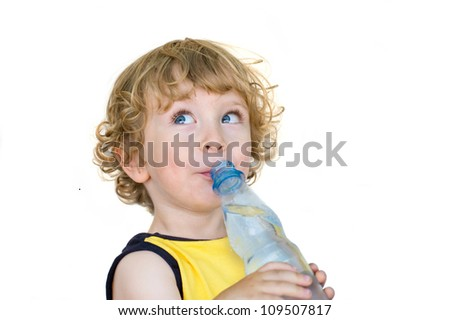 Child drinking from  water bottle - stock photo