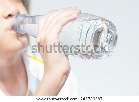 Child drinking pure water  - stock photo