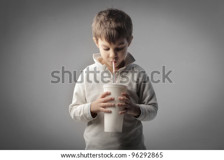 Child drinking with a straw - stock photo