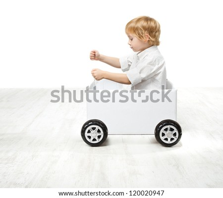 Child driving box car. Creativity and innovation concept - stock photo