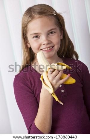 Child Eating Banana - stock photo