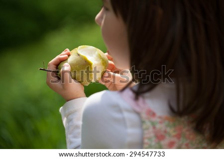 child eating healthy pear - stock photo