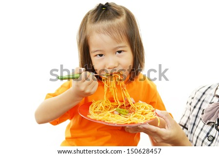 Child eating spaghetti - stock photo