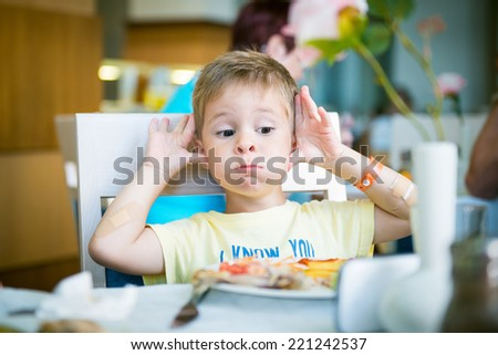 child eats at the table  - stock photo