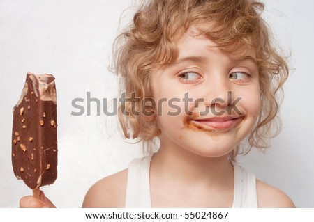 Child eats ice - stock photo