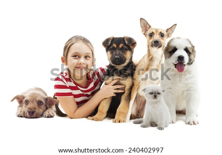child embracing puppies - stock photo