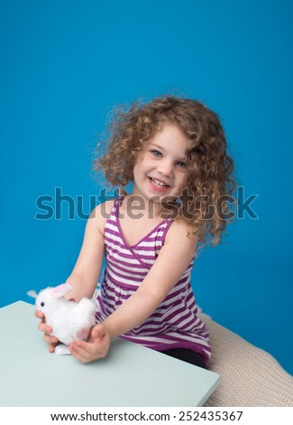 Child engaged in an Easter Activity with a Bunny  - stock photo