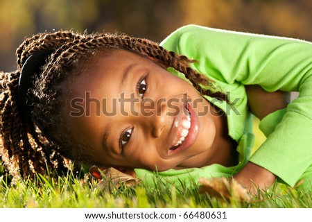 Child enjoying nice sunny day in a park. - stock photo