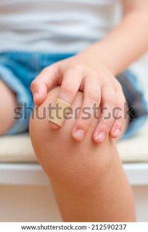 Child finger with an adhesive bandage. - stock photo