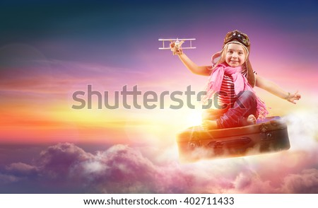 Child Flying With Fantasy On Suitcase In The Sky  - stock photo