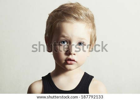 Child. Funny Little Boy. Handsome Boy with Blue Eyes. Close-up portrait  - stock photo