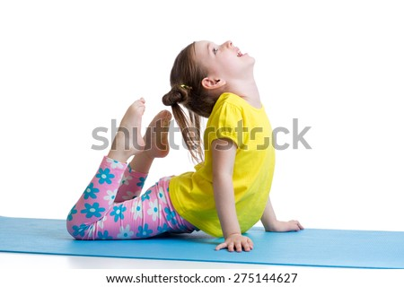 Child girl doing gymnastic exercises on mat isolated - stock photo