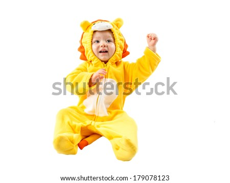 Child girl,dressed in lion carnival suit, isolated on white background. Baby zodiac - sign Leo. The concept of childhood and holiday - stock photo