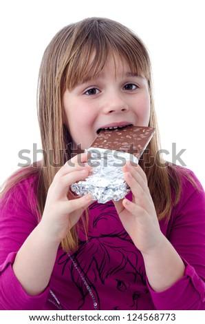 Child girl eating chocolate - stock photo