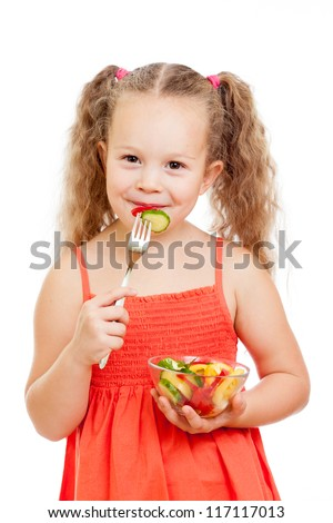 child girl eating healthy food vegetables - stock photo