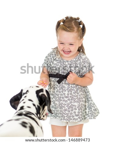 child girl feeding dog - stock photo
