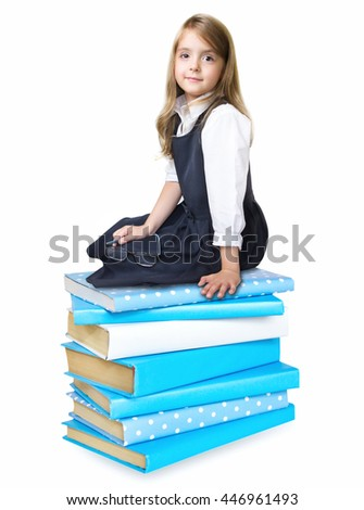 Child girl over stack of books isolated on white.. Schoolgirl sitting on pile of books. Elementary education concept.Back to school icon.Kid's literature. - stock photo