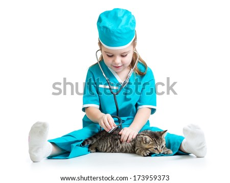 Child girl playing doctor with cat kitten - stock photo