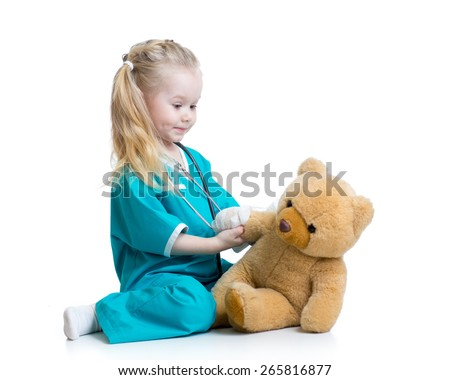 child girl playing doctor with plush toy isolated - stock photo