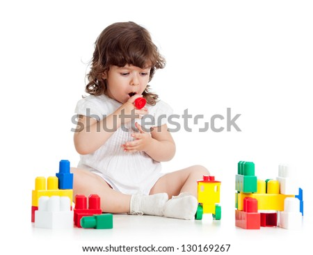 child girl playing with construction set - stock photo