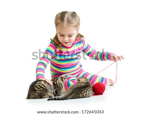 child girl playing with kittens isolated on white background - stock photo