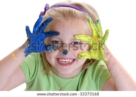 Child (Girl) smiles after painting session with colorful hands - stock photo