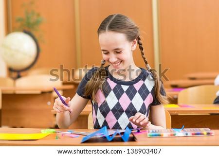 child girl with felt-tip pen - stock photo