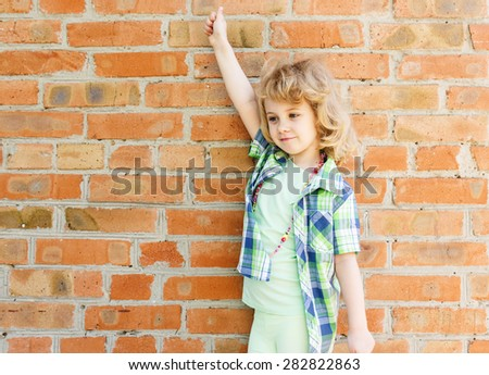 Child girl with happy expression hand up - stock photo