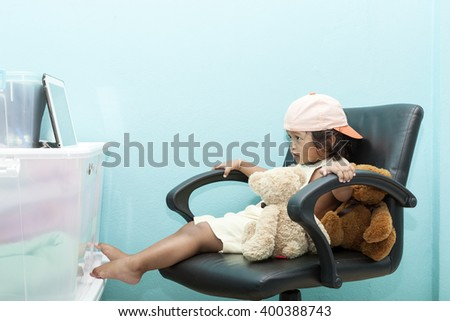 child girl  with tablet PC. asian baby girl - stock photo