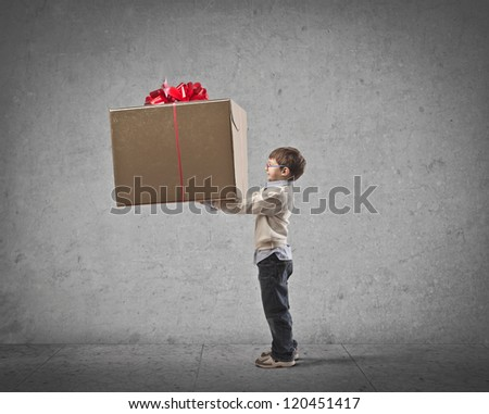 Child giving a great gift to someone - stock photo