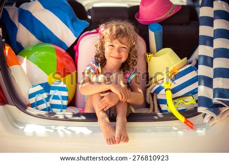 Child going on summer vacation. Car travel concept - stock photo