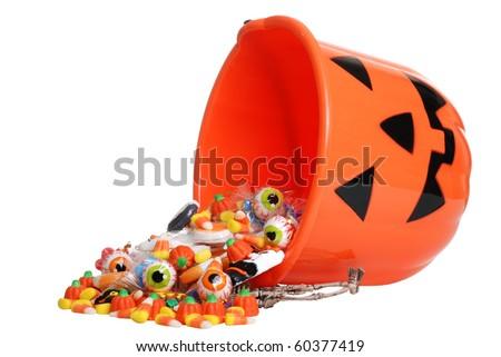 child halloween pumpkin bucket spilling candy - stock photo